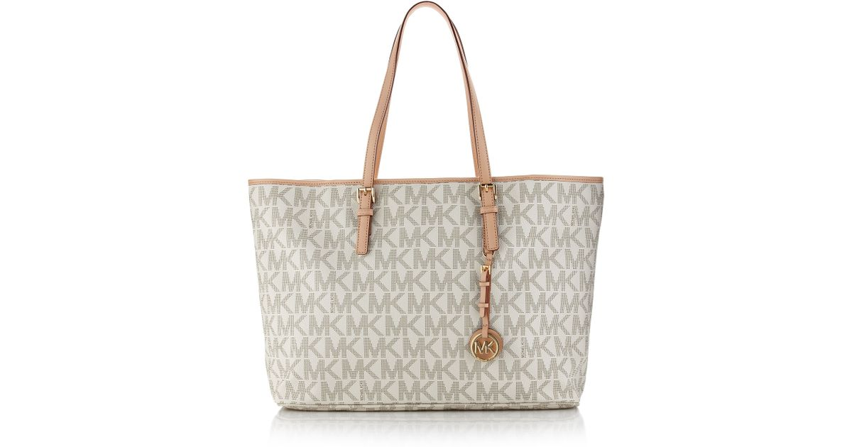 140650cf0efe ... best price lyst michael michael kors jet set logo laptop travel tote in  natural a1e8f f9875
