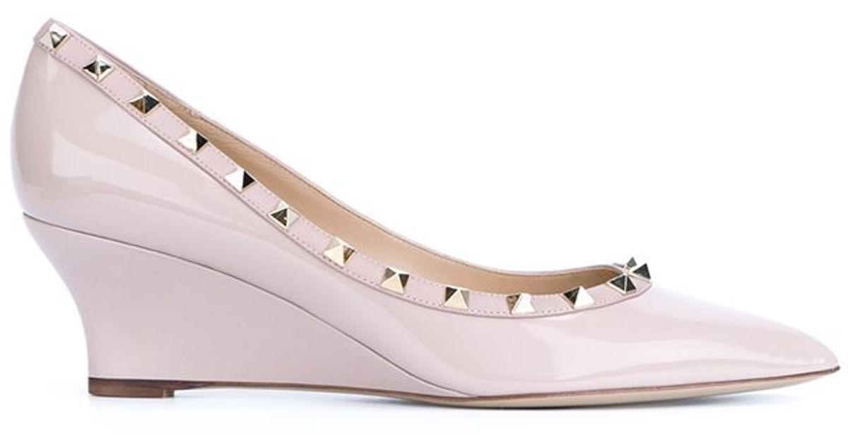 22635517d94 Lyst - Valentino  rockstud  Wedge Pumps in Pink