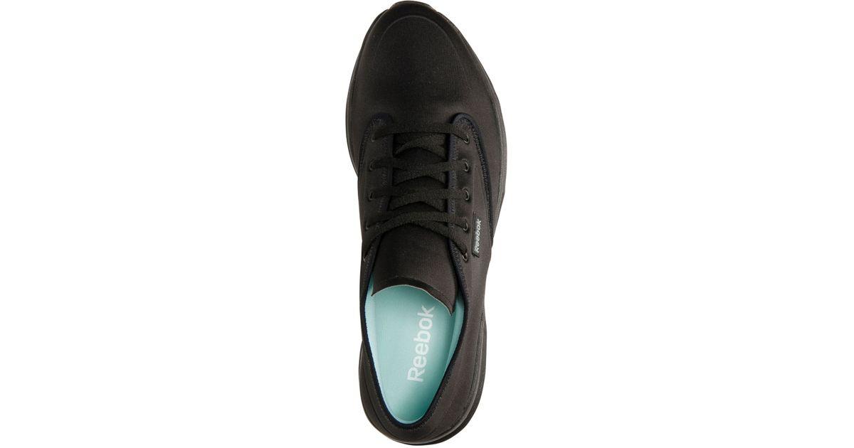50489ddafce Lyst - Reebok Women s Skyscape Runaround Walking Sneakers From Finish Line  in Black