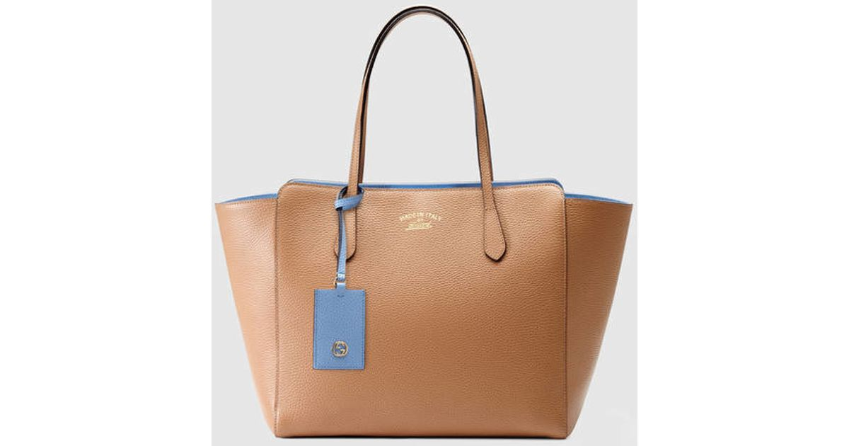 db56a5fdceb102 Gucci Gucci Swing Medium Leather Tote in Natural - Lyst