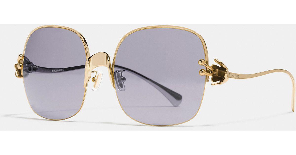 368350e3edd Lyst - COACH Tea Rose Sunglasses in Purple