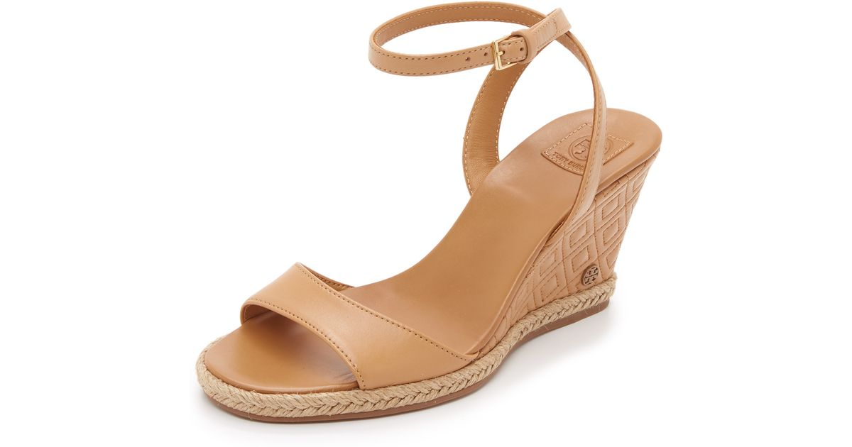 bc83fec236e Lyst - Tory Burch Marion Quilted Wedge Sandals in Natural