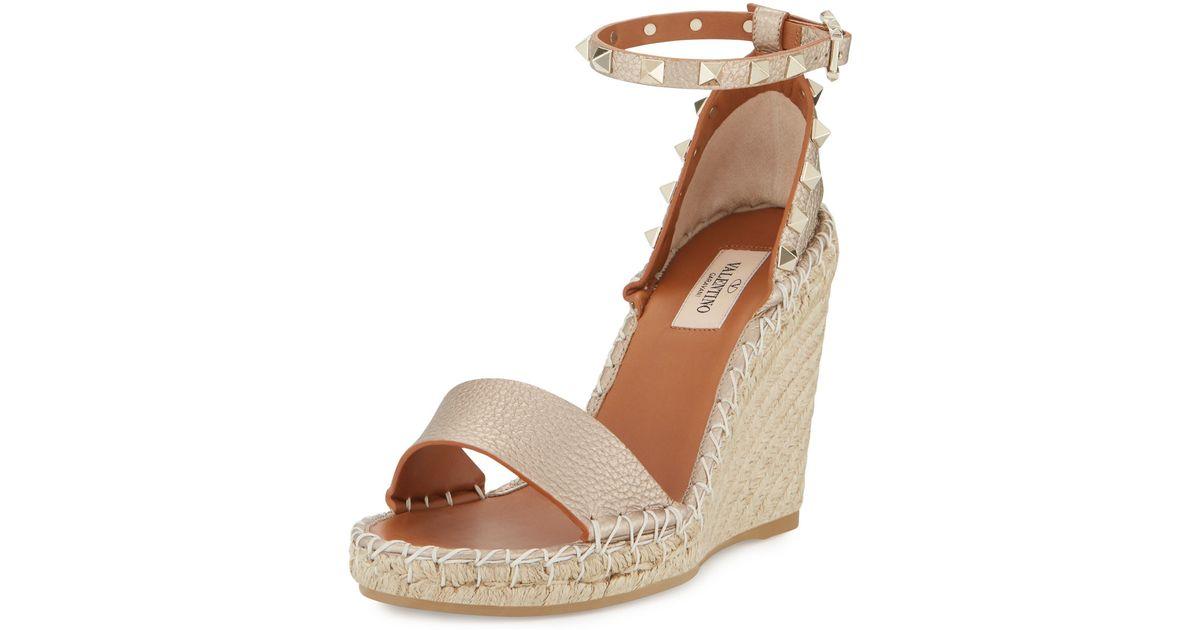 00309257b335 Lyst - Valentino Rockstud Metallic Ankle-wrap Wedge Sandal in Natural
