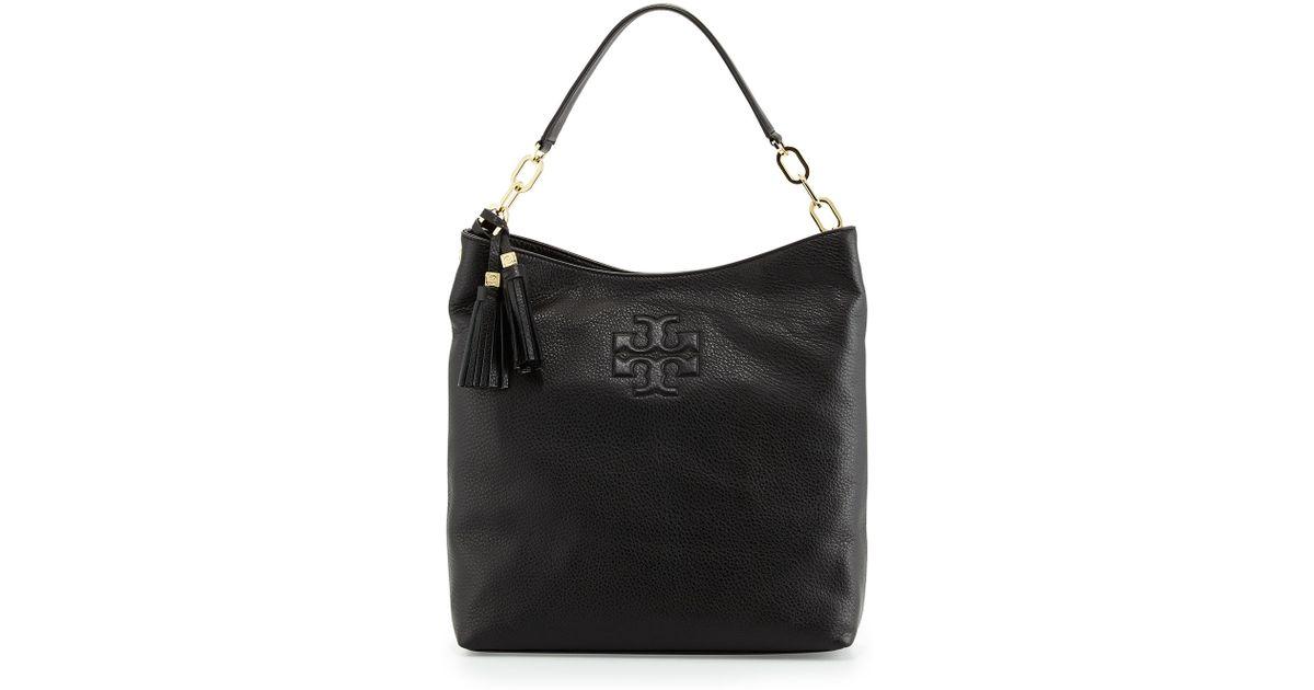 7080ccfa59e3 Lyst - Tory Burch Thea Leather Tassel Hobo Bag in Black