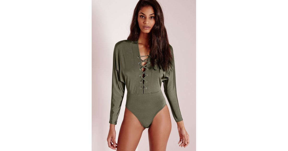 Lyst - Missguided Slinky Batwing Lace Up Bodysuit Bronze in Green 437425f6d