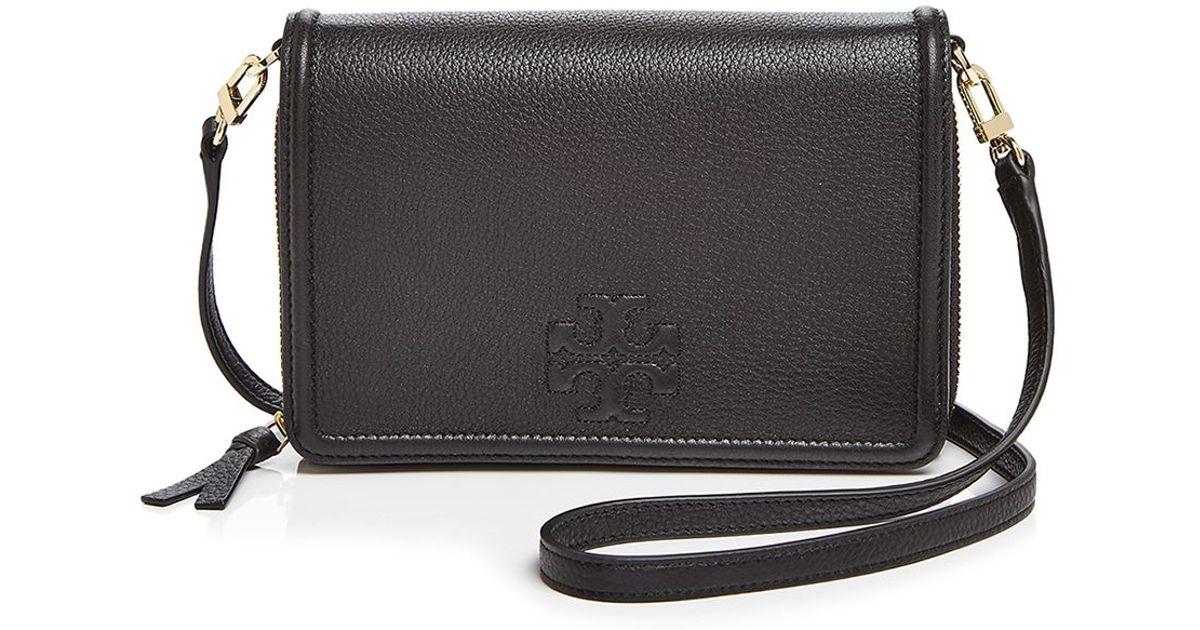 283aa7d8f57 Lyst - Tory Burch Thea Flat Wallet Crossbody in Black