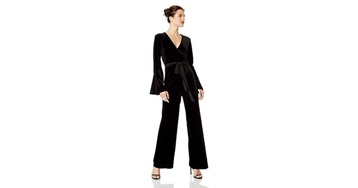 326a3424580 Lyst - Calvin Klein Faux Wrap Bell Sleeve Jumpsuit in Black