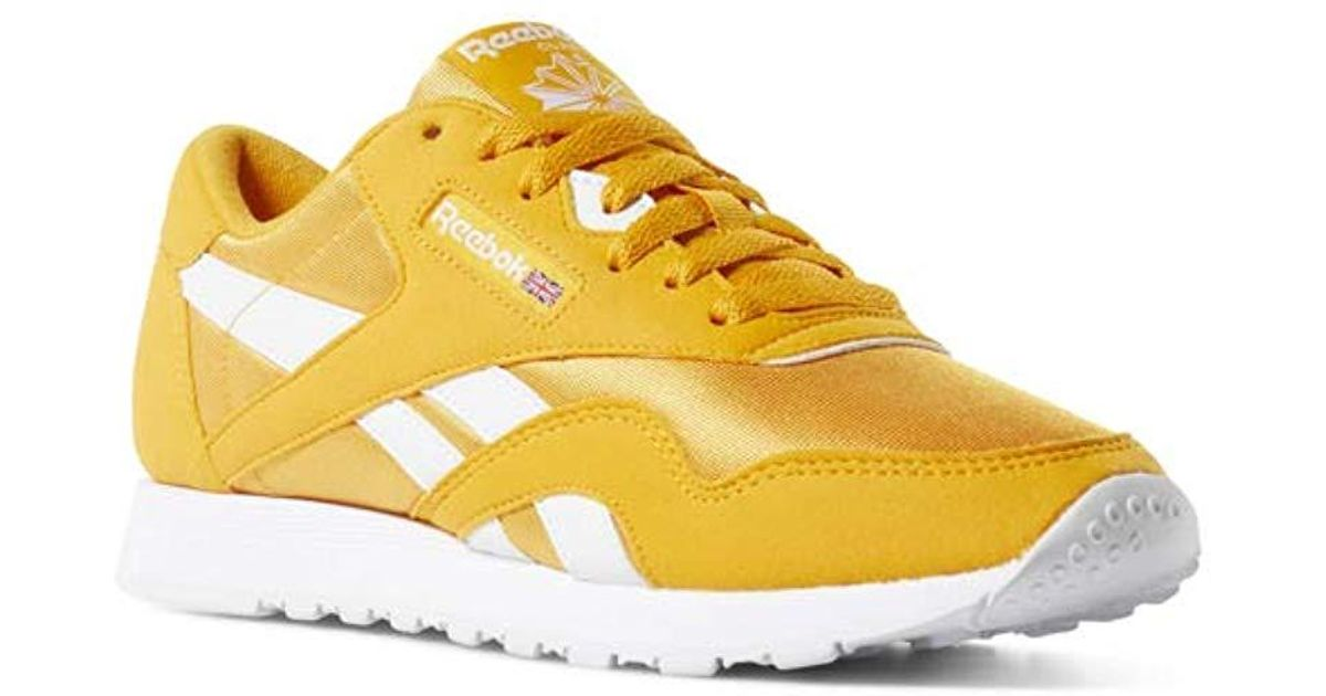 b24c191a529c reebok-Trek-GoldWhite-Classic-Nylon-Sneaker-Trek-Goldwhite-65-M-Us.jpeg