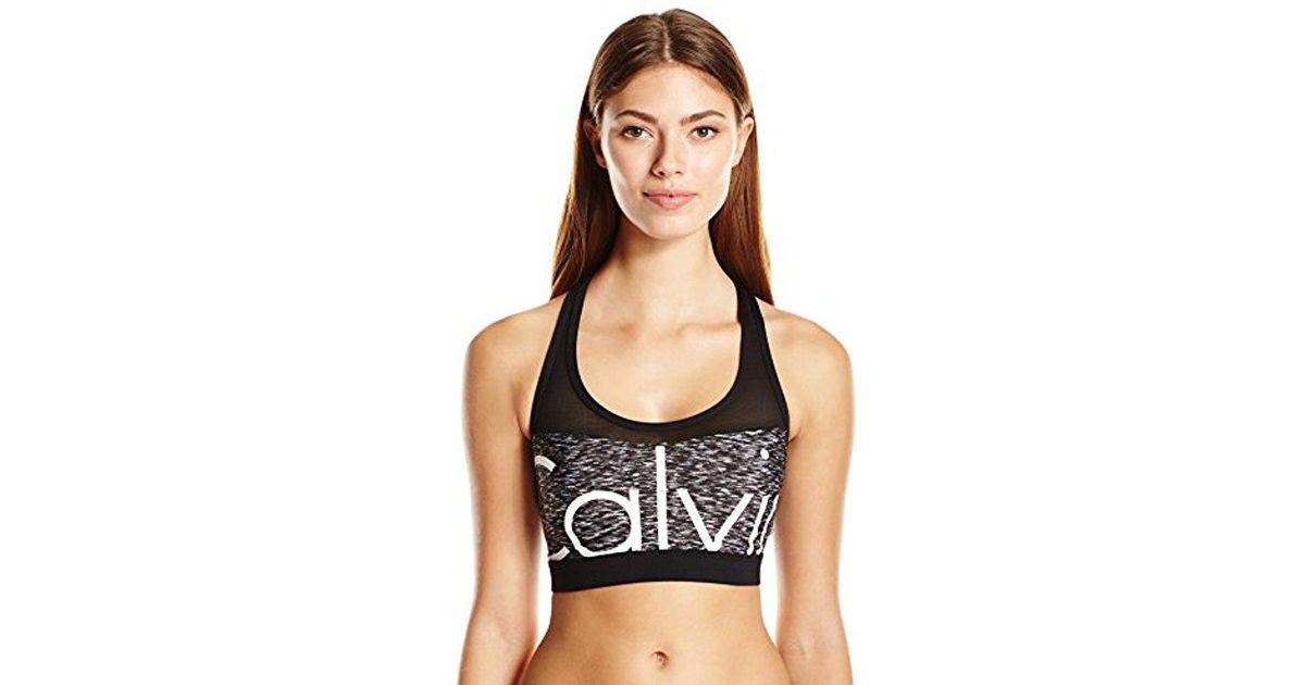 c41a0d8b59 Lyst - Calvin Klein Space Dye Printed Mesh Insert Sports Bra Bikini Top in  Black