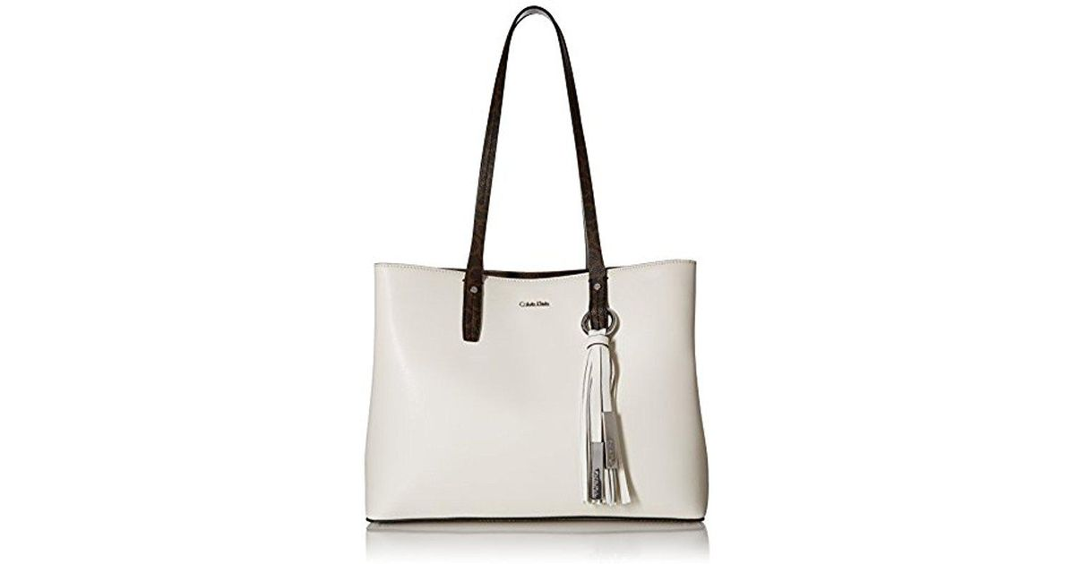 dc3064560e Calvin Klein Maggie Mercury Leather East/west Tote in White - Lyst