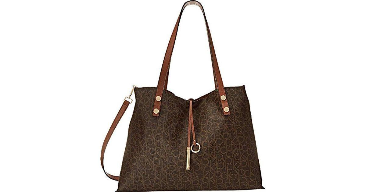 060317b4e29d Lyst - Calvin Klein Reversible E/w Logo Tote Bag in Brown