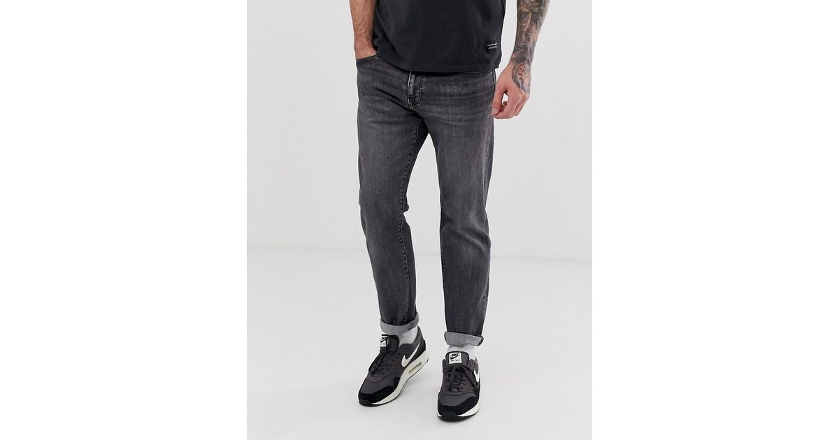 6aa9349d75e Levi's 502 Regular Tapered Fit Jeans In Gobbler Advance Washed Black in  Black for Men - Lyst