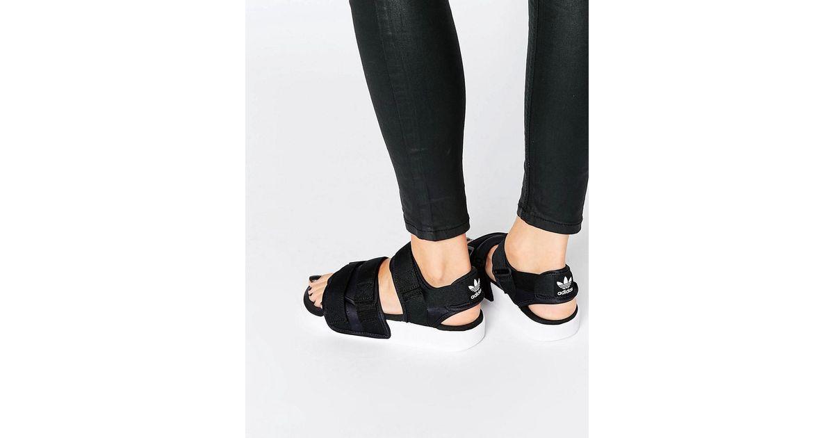 3322dfbb2913 Lyst - adidas Originals Originals Adilette Chunky Strap Sandal Flat Sandals  in Black