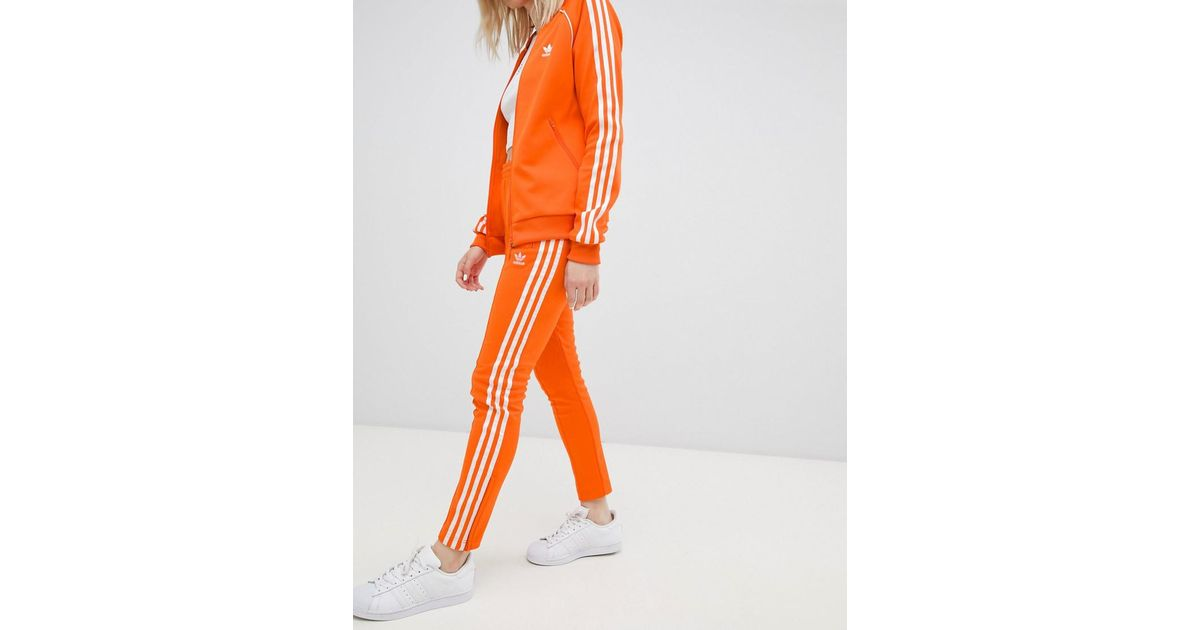 online store 4944d 1cc56 adidas Originals Three Stripe Cigarette Pants In Orange in Orange - Lyst