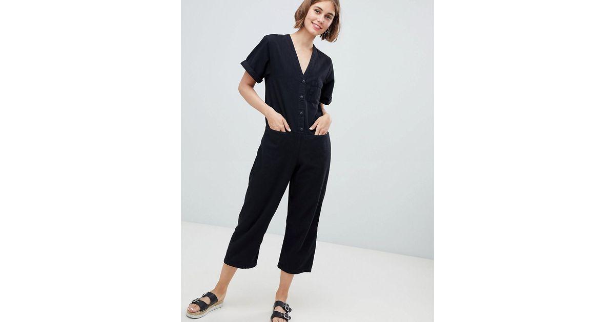 eefeb9ea1ad Monki Denim V Button Front Jumpsuit in Black - Lyst