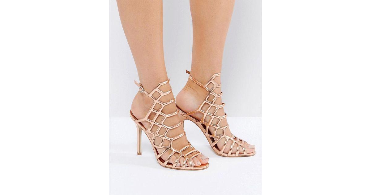 4917eea79d6b Steve Madden Slithur Rose Gold Caged Heeled Sandals in Metallic - Lyst