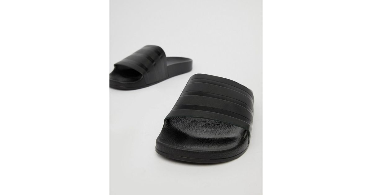 low priced cbfae e821f adidas Originals Adilette Sliders In Black Cq3094 in Black for Men - Lyst