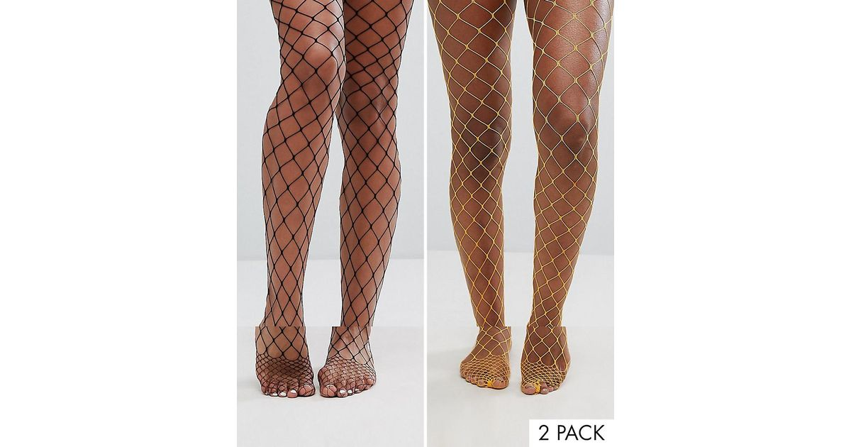 0770dc0723cb8 ASOS 2 Pack Oversized Fishnet Tights In Black And Orange - Lyst