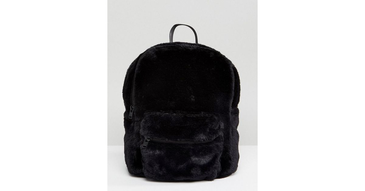 cb8b037f1000 Lyst - Hollister Furry Backpack in Black
