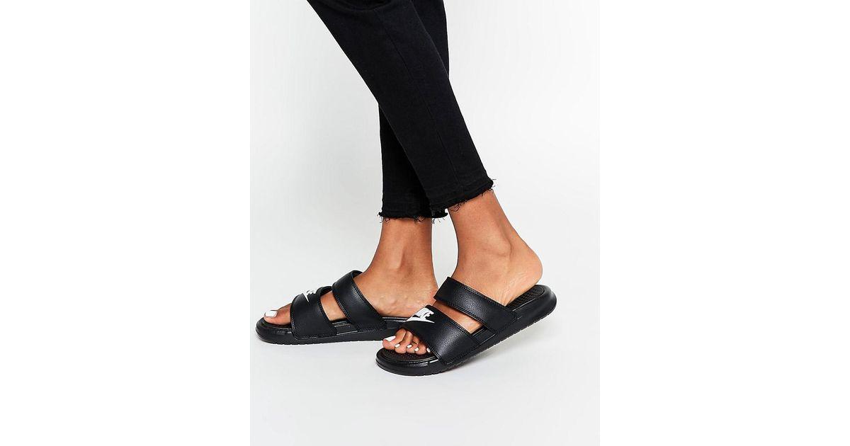 3f9e30f3a6d Nike Benassi Duo Flat Sandals in Black - Lyst