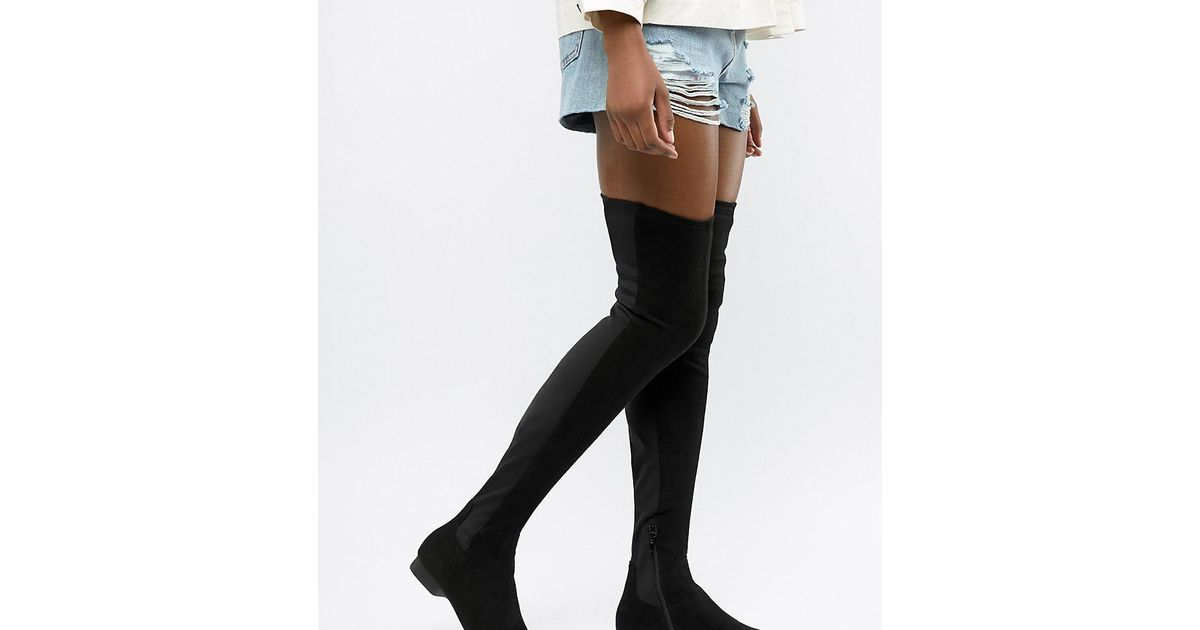 de01dae7856 Asos Slim Kelby Flat Elastic Thigh High Boots in Black - Lyst
