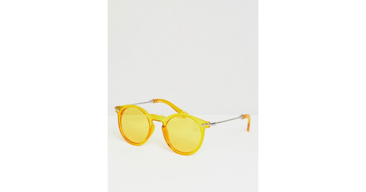 7da0a57286 Gafas de sol redondas en amarillo transparente con lentes en amarillo de  ASOS de hombre de color Amarillo - Lyst