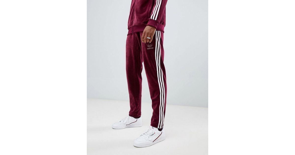 Pantalon de jogging en velours Adidas Originals pour homme en coloris Red
