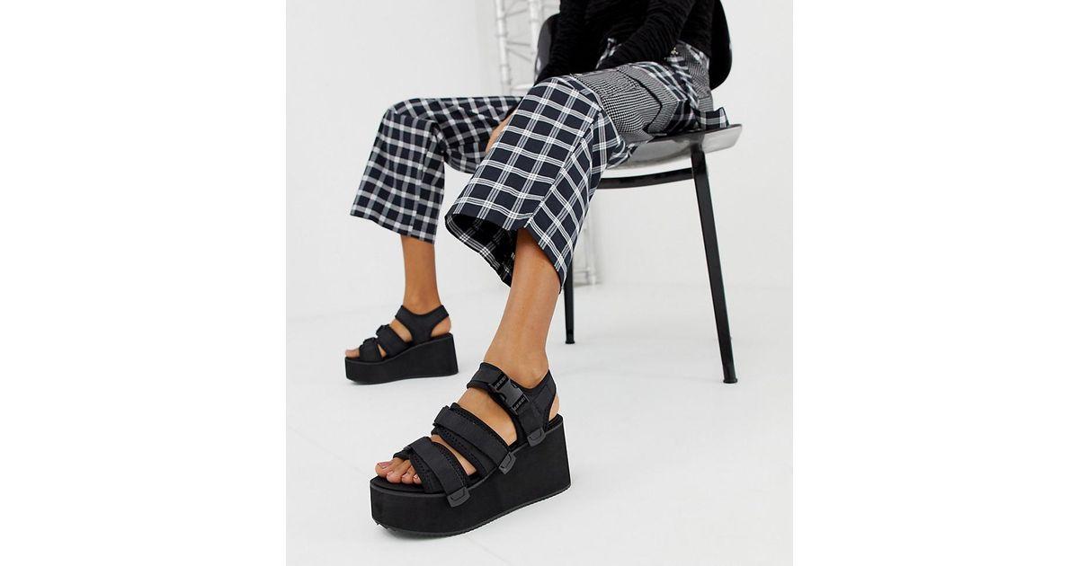 bc8699b81d6 Lyst - Blink Sporty Platform Wedge Sandals in Black