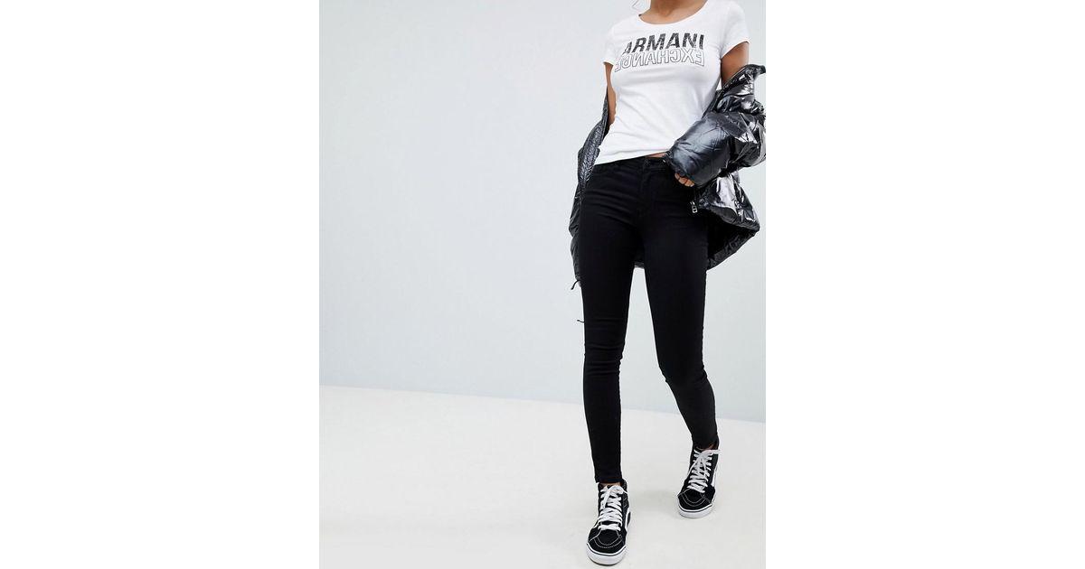 0119f07924cc Armani Exchange Super Skinny Mid Rise Jeans in Black - Lyst
