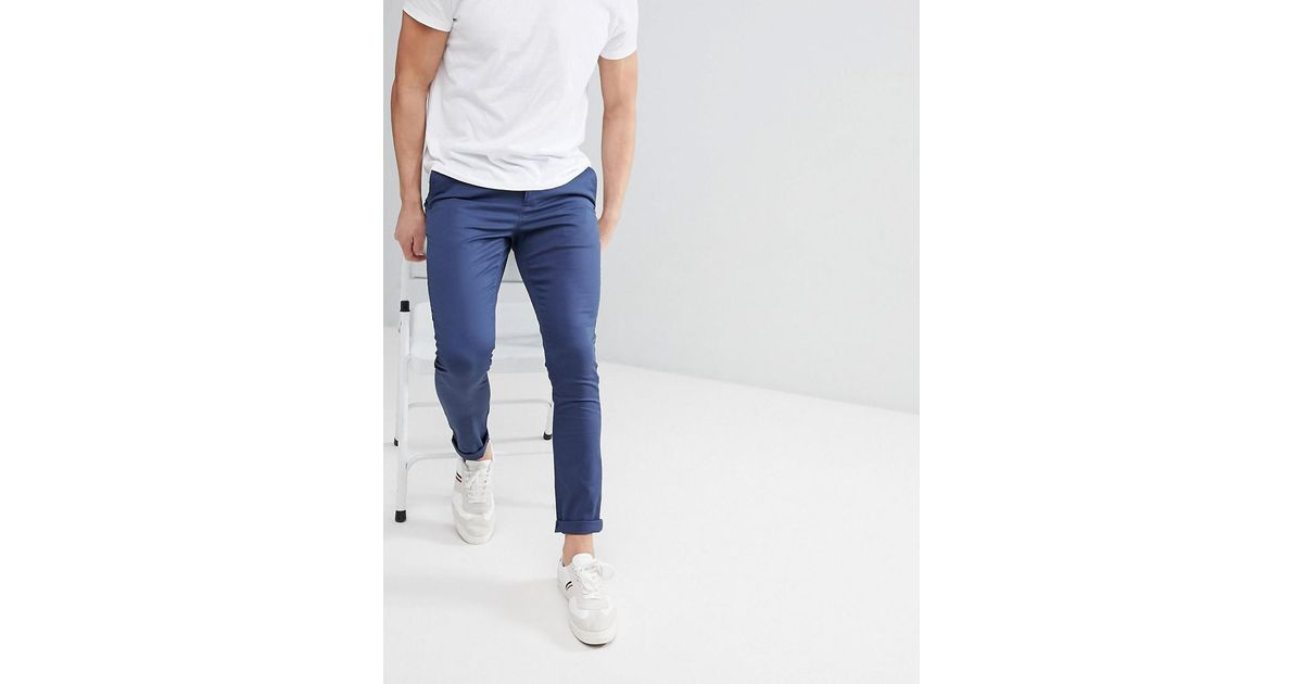 3dabe3bc ASOS Super Skinny Chinos In Midnight Blue in Blue for Men - Lyst