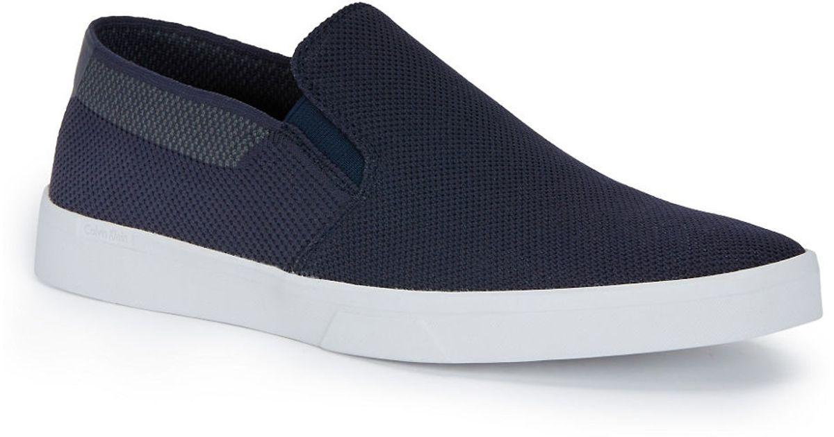 calvin klein ives slip on sneakers in blue for men navy. Black Bedroom Furniture Sets. Home Design Ideas