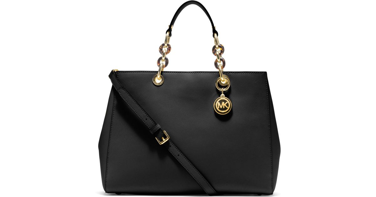 04e26438503bdd ... best price lyst michael kors cynthia large saffiano leather satchel in  black 7bc20 c4d97