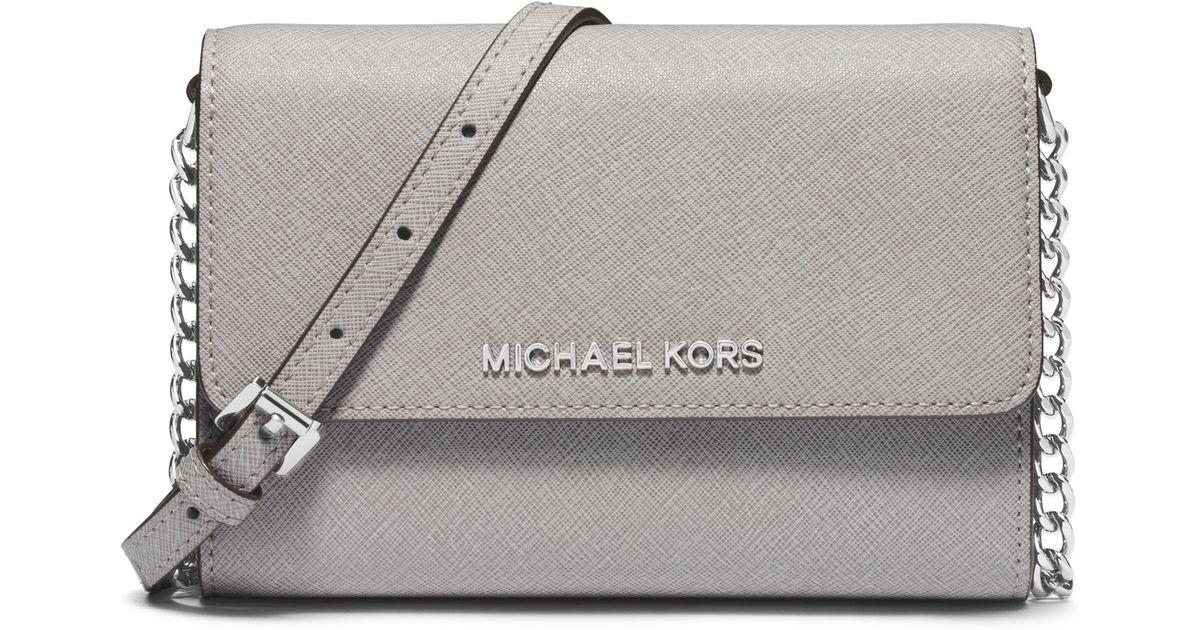 e8be77708ff3 Lyst - MICHAEL Michael Kors Jet Set Travel Large Saffiano Leather  Smartphone Crossbody Bag in Gray