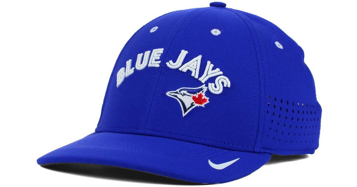 brand new 176de f3377 ... lyst nike toronto blue jays vapor swoosh flex cap in blue for men
