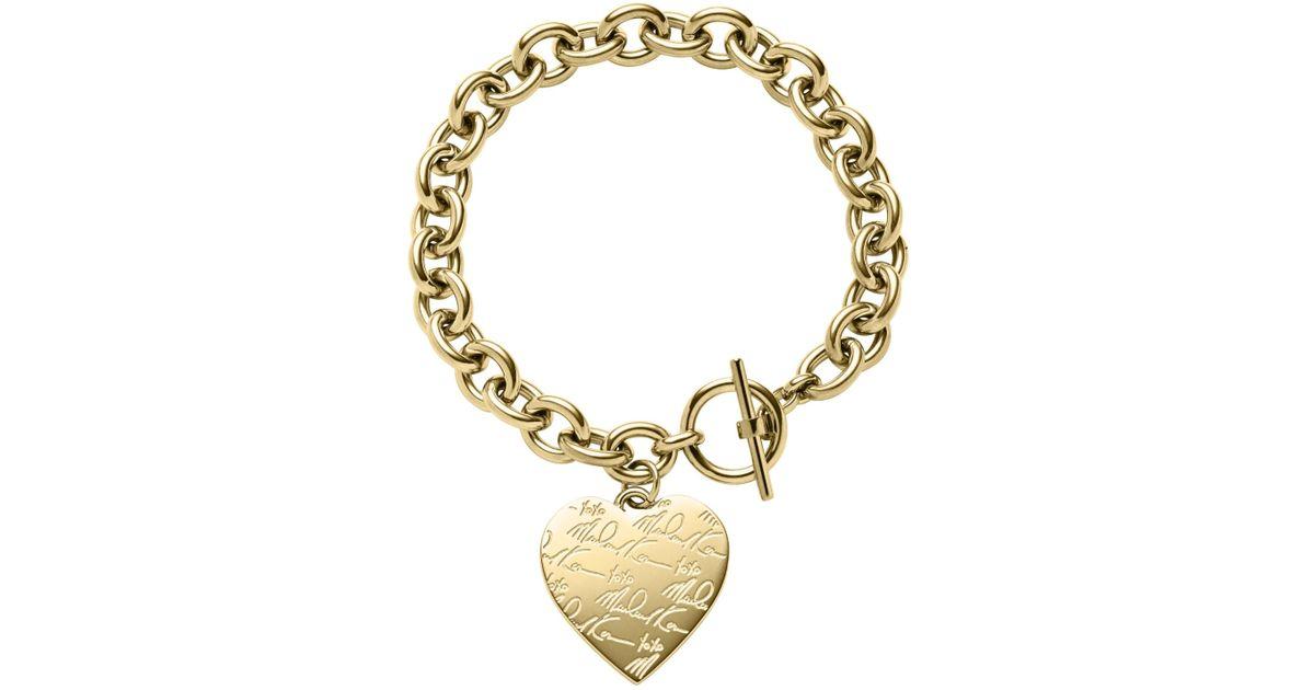 a55a267d4ee8d Lyst - Michael Kors Pavé Gold-tone Heart Charm Bracelet in Metallic