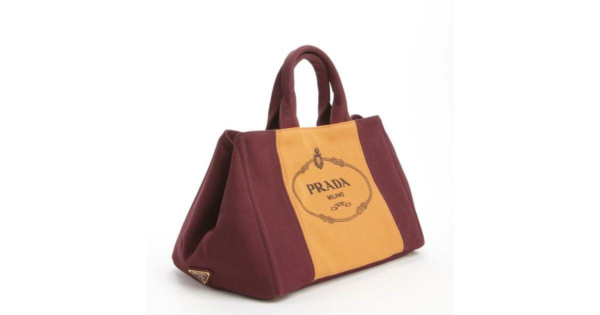 c9623ac98d61 ... tote in tan black. 123456789101112 8393a acc61; cheapest lyst prada  burgundy orange canvas logo crossbody top handle bag in purple 73250 e5cc7