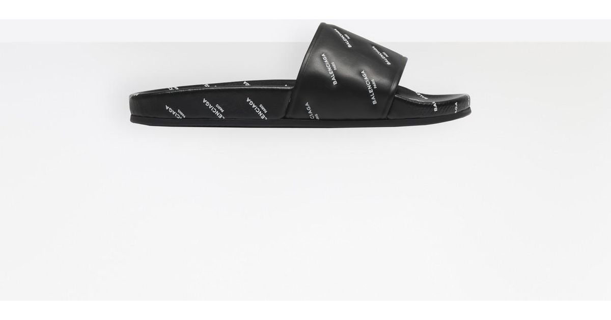 f668155d4944 Lyst - Balenciaga Slides With Embossed Logo in Black for Men - Save  16.15384615384616%