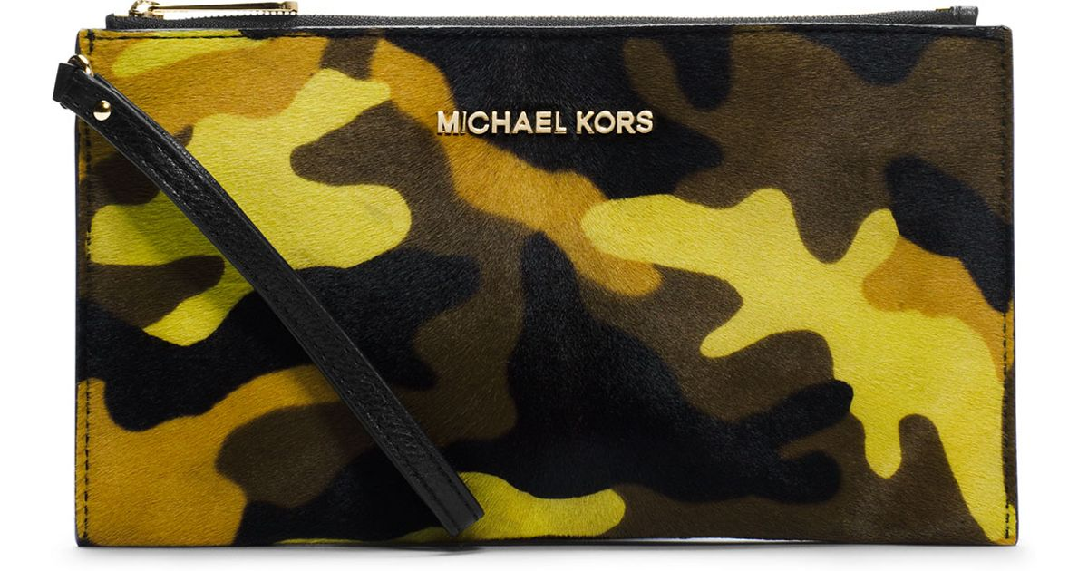 642e90a6dc39c9 Michael Kors Michael Large Bedford Camo Calfhair Zip Clutch in Yellow - Lyst
