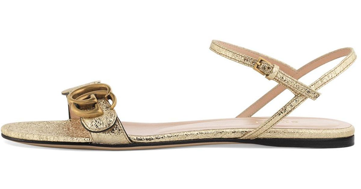 8d7f9a9d49a4 Lyst - Gucci Metallic Laminate Leather Double G Sandal in Metallic