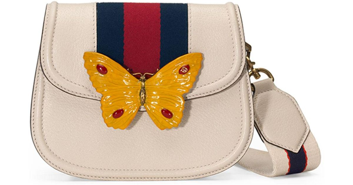 b42abdb60 Gucci Linea Totem Small Leather Shoulder Bag With Butterfly & Web Strap in  White - Lyst