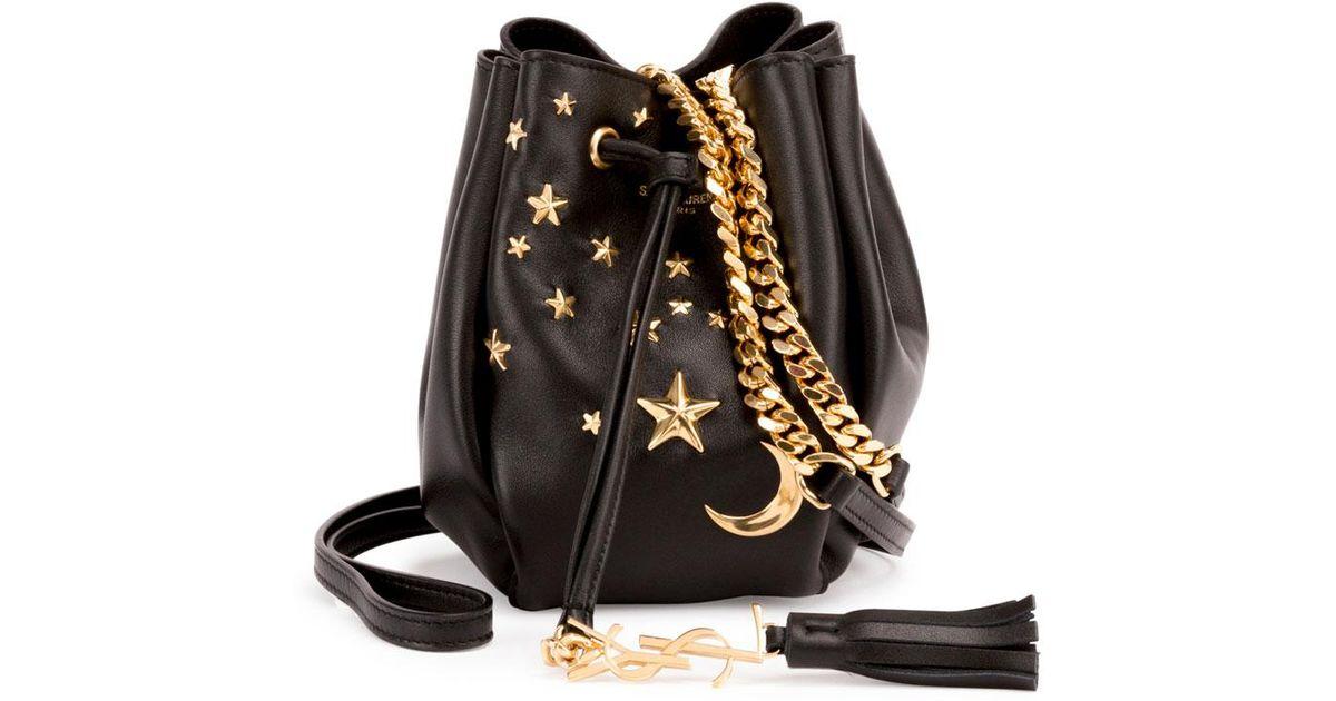 da28a216356f Lyst - Saint Laurent Monogram Small Star Studded Leather Bucket Bag in Black