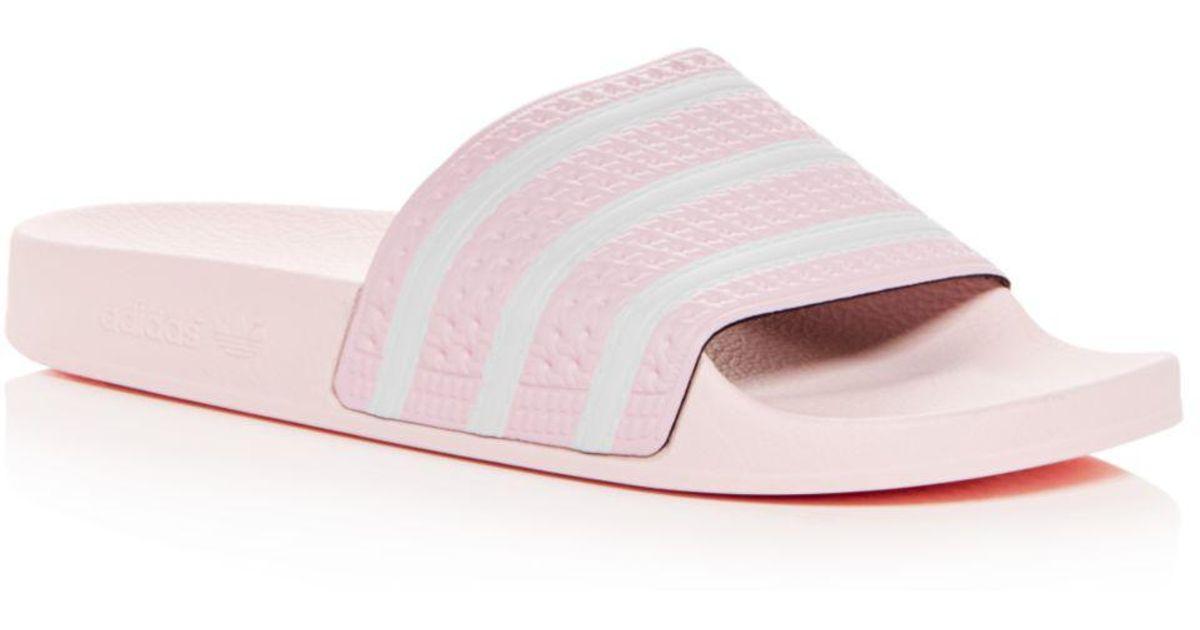 on sale e91cc 0f0c6 adidas Mens Adilette Slide Sandals in Pink for Men - Lyst