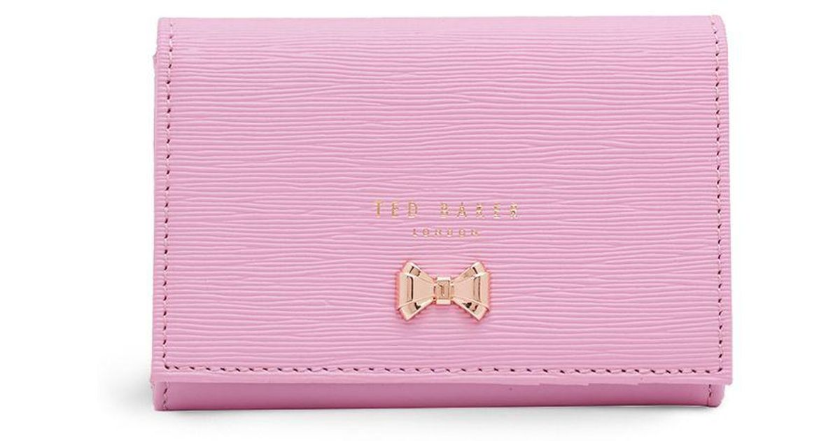 1105029d764c1 Lyst - Ted Baker Myah Curved Bow Mini Wallet in Pink