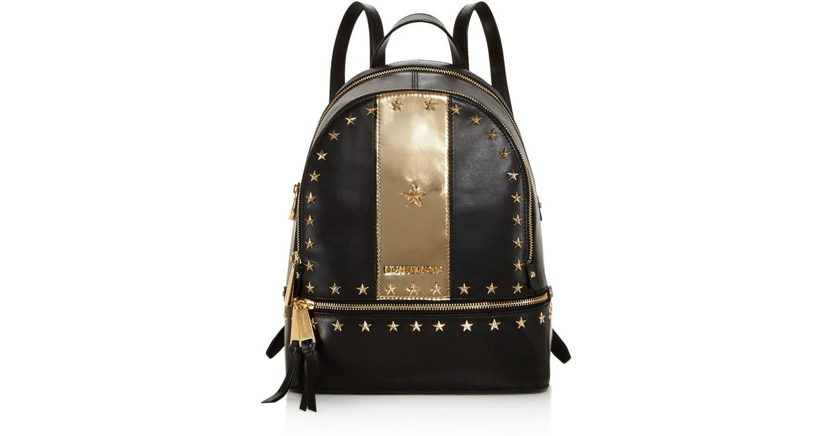 7d94001079e6d ... uk michael michael kors rhea star stud medium leather backpack in black  lyst 11940 c0e5c