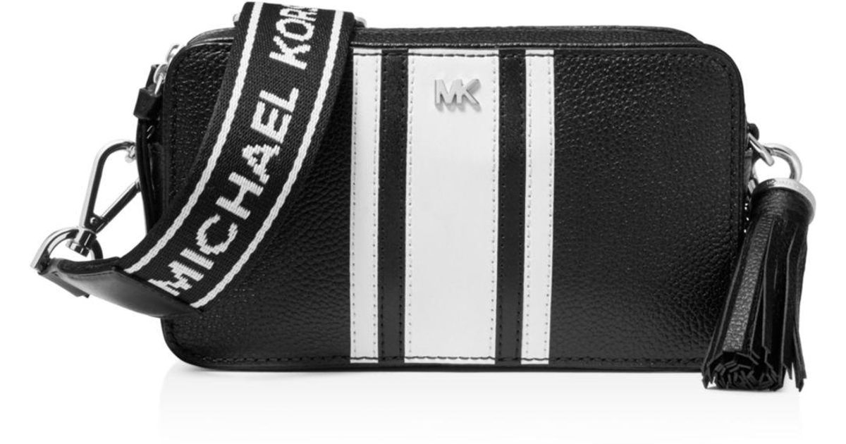 d0333f27890a06 Michael Kors Small Striped Leather Camera Crossbody in Black - Save 61% -  Lyst