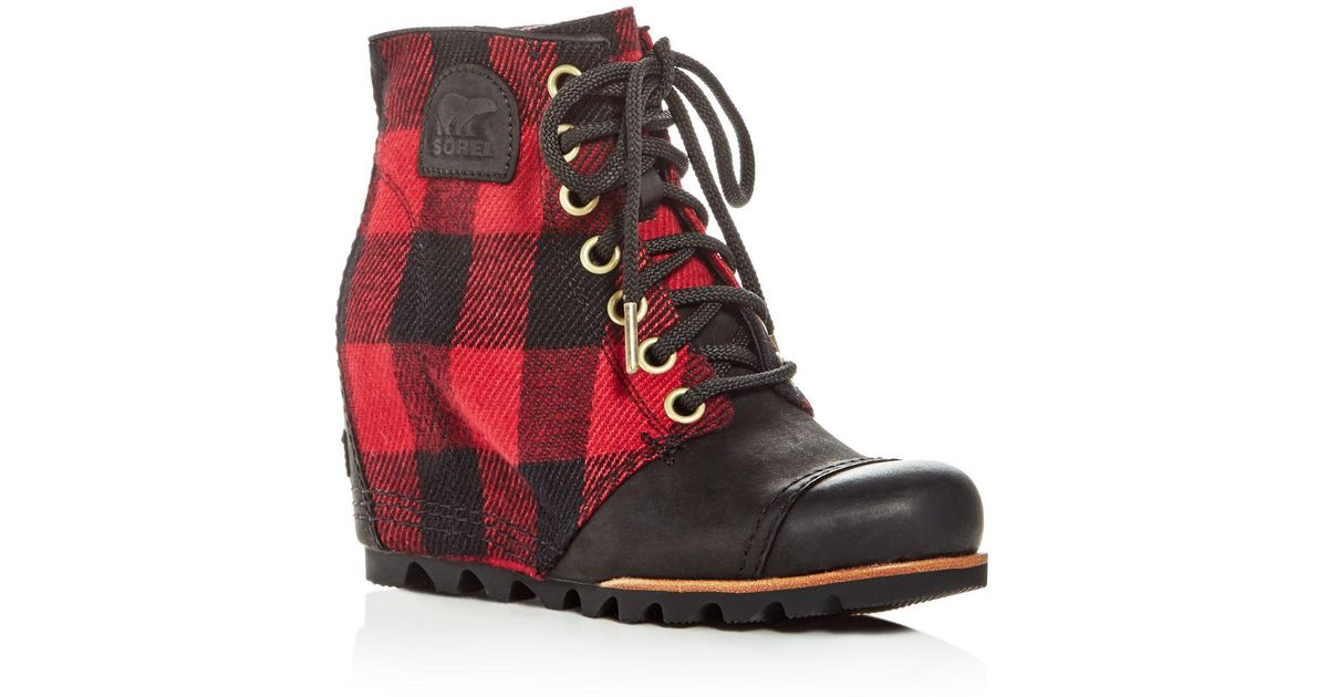 af9c97760ef Lyst - Sorel Women s Pdx Leather   Plaid Lace Up Wedge Booties in Black