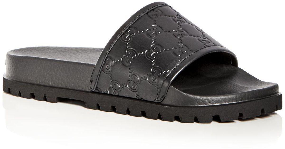 e7b224fc4 Gucci Men's Pursuit Treck Embossed Leather Slide Sandals in Black for Men -  Lyst