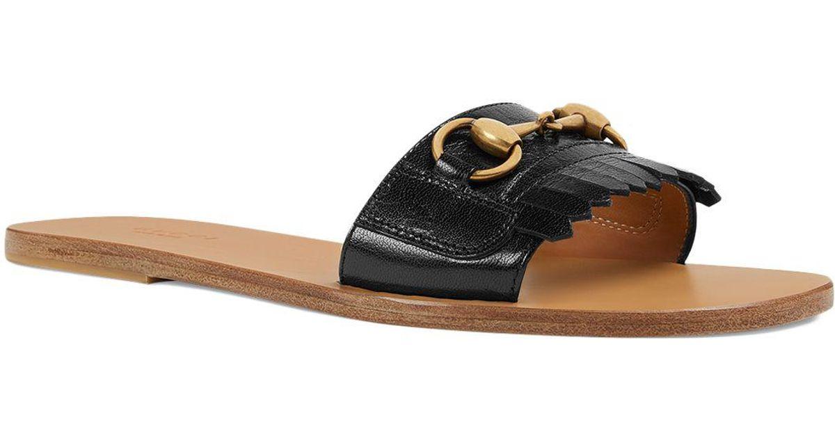 0068e30875e8 Lyst - Gucci Women s Varadero Fringe Leather Slide Sandals in Black