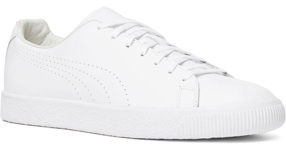 6f041373bd588e The Kooples X Puma Clyde Lace Up Sneakers in White - Lyst