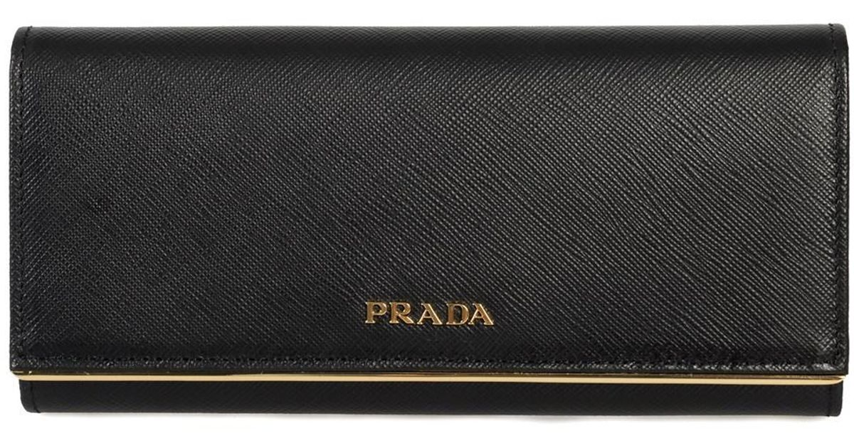 e3fd807a51c1 ... usa lyst prada black saffiano leather flap wallet with metal bar detail  1mh132 qme f0002 in